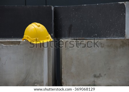 Yellow safety helmet on construction site