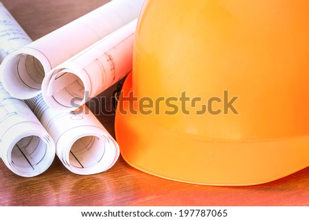 yellow  safety helmet with  blue prints  - stock photo