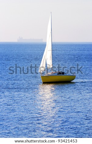 yellow sail yacht sailing. Riga, Latvia - stock photo
