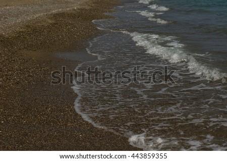 Yellow sand beach and sea waves - stock photo