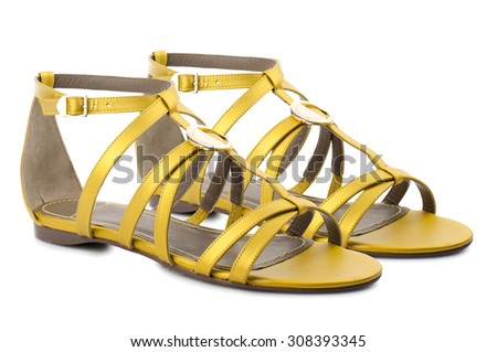 Yellow sandals isolated on white background.