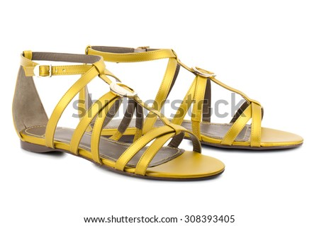 Yellow sandals isolated on white background. - stock photo