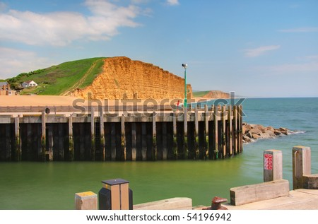Yellow sandstone ('Bridport Sands') cliffs in West Bay, Dorset. Part of the UNESCO Jurassic Coast World Heritage Site - stock photo