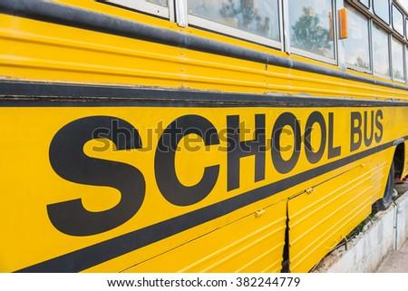 Yellow school bus park on floor - stock photo