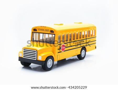 Yellow school bus plastic and metal toy isolated on a white background, represent every children were safe to go to school when they arrived to this bus on time.