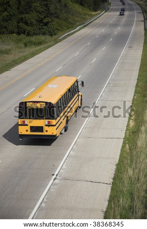 Yellow School Bus seen from a bridge. - stock photo