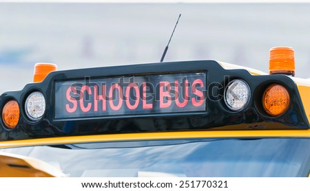 Yellow school bus with a sign - stock photo