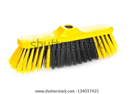 Yellow scrubbing broom on white background - stock photo
