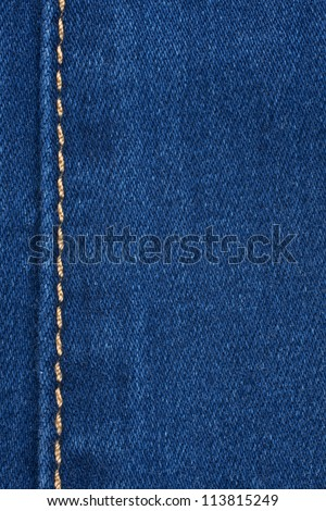 Yellow seam on denim, background, texture - stock photo
