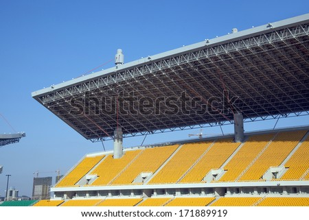 Yellow seat in stadium - stock photo