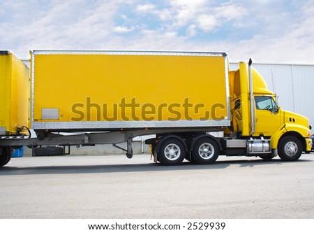 Yellow semi truck - stock photo