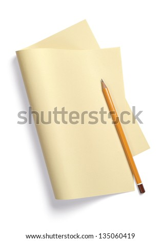 Yellow sheet of paper, folded in half on white