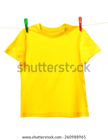 Yellow shirt hanging on the clothesline. Image isolated on white background   - stock photo