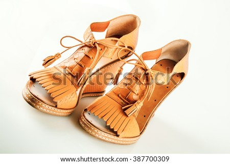 yellow shoes, sandals, isolated on a white background