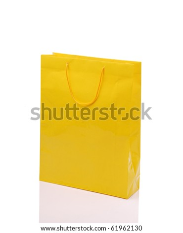 Yellow shopping bag on isolated white background