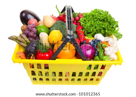 yellow shopping basket full of fresh fruit and vegetables, isolated on a white background.