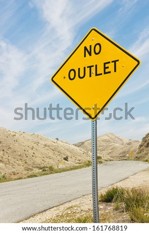 Yellow sign reads no outlet in a rural community.  - stock photo