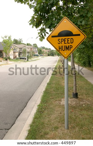 Yellow sign road - Speed hump - stock photo