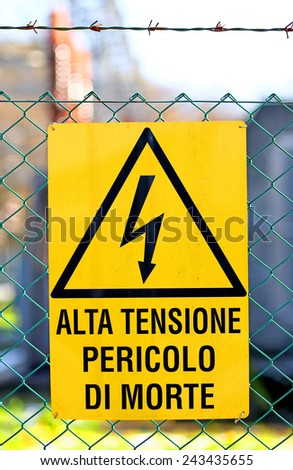 yellow signboard of danger high voltage in power plant electricity production - stock photo