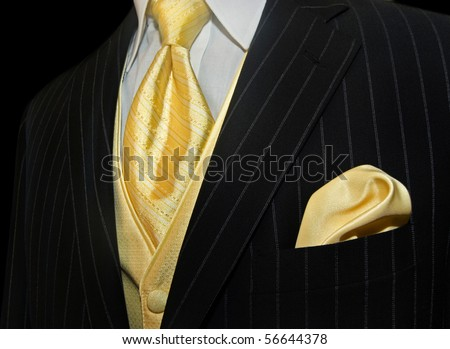 yellow silk necktie and handkerchief in tuxedo