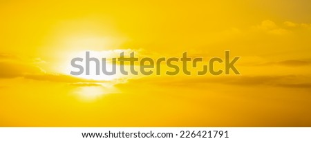 yellow sky with clouds over Alghero at sunset. Sardinia, Italy. - stock photo