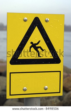 Yellow slippery surface warning sign – Add your own text. - stock photo