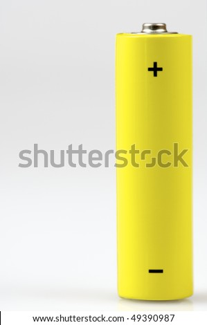 yellow small battery with positive and negative signs - stock photo