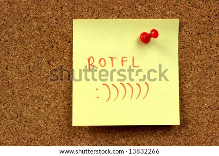 Yellow small sticky note on an office cork bulletin board. Internet acronym for: Rolling On The Floor Laughing. - stock photo