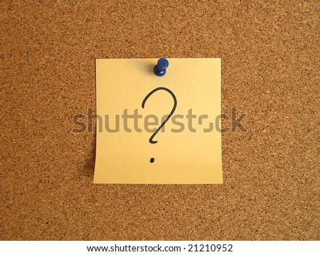 Yellow small sticky note on an office cork bulletin board. Surprise and confusion message. - stock photo