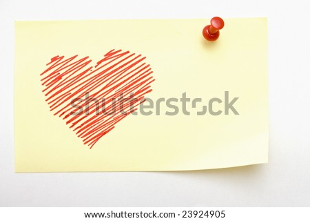 Yellow small sticky note with an heart sketched - stock photo