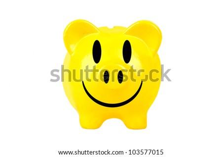 yellow smiley piggy bank on white background - stock photo