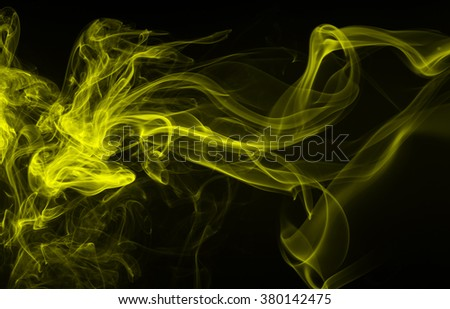 Yellow smoke abstract on black background, movement of yellow smoke, darkness concept - stock photo