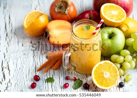 Yellow smoothie, healthy juicy vitamin drink diet or vegan food concept, fresh vitamins, homemade refreshing fruit beverage