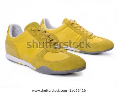 Yellow sneakers - stock photo