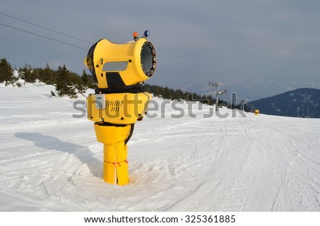 Yellow snow cannons next to the ski slopes, mountain resort Kopaonik, Serbia