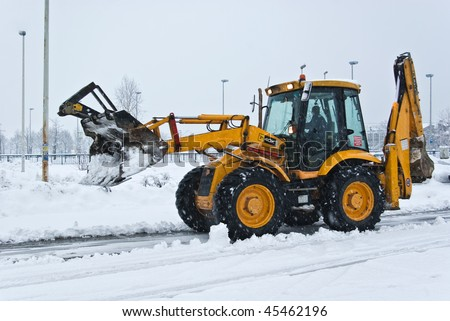 yellow snow plow cleaning a road in zagreb - stock photo