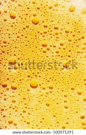 yellow soap foam  texture- bubbles abstract background on the water