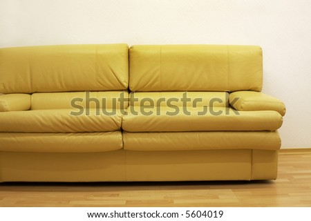 Yellow sofa at a wall at modern office