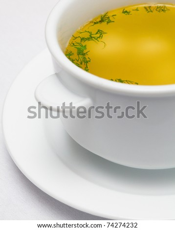 yellow soup with greens - stock photo