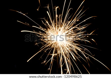 yellow sparkler holiday background on black - stock photo