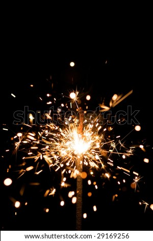 yellow sparkler with fire particles