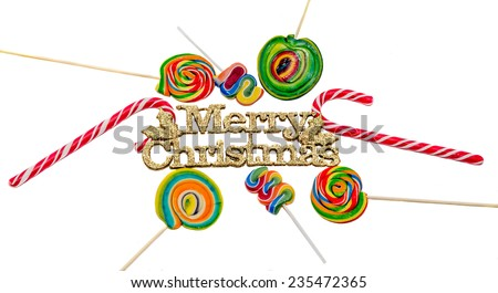 Yellow sparkley Merry Christams write, letters with colored candy sticks and lollipops, isolated - stock photo