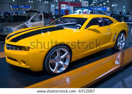 Yellow sports car at auto show - stock photo