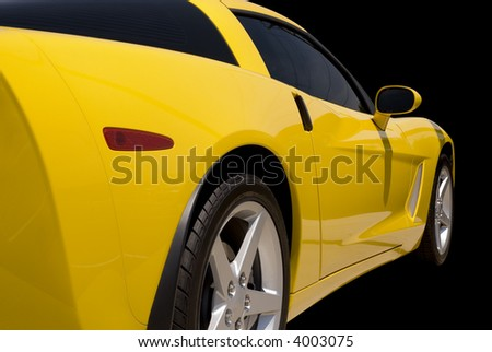Yellow  sports car isolated on a black background.