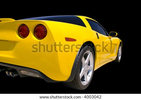 Yellow sports car isolated on a black background. Clipping path included.