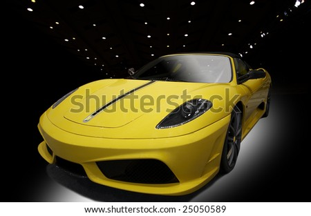 yellow sports car on a black background