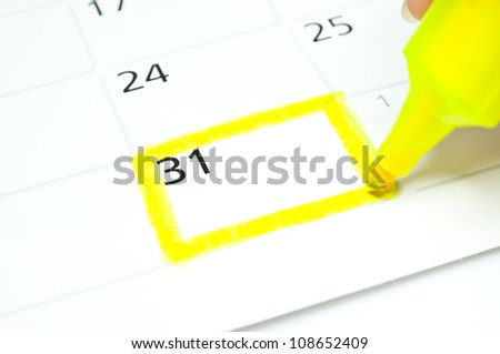 Yellow square. Mark on the calendar at 31. - stock photo