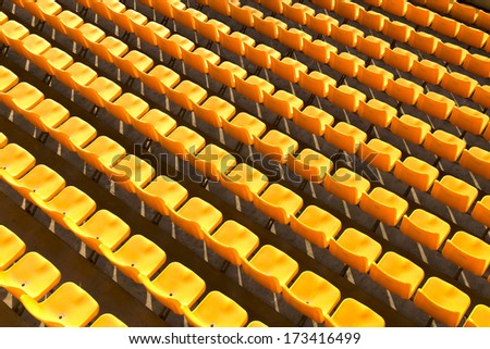 Yellow stadium seats - stock photo