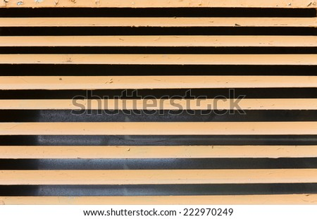 yellow steel ventilation grille on the wall of a building - stock photo