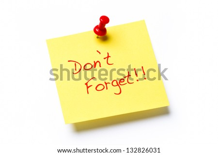 Yellow sticky note isolated on a white background with the words Don't Forget - stock photo